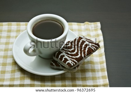cup of coffee and chocolate chip cookies on table - stock photo