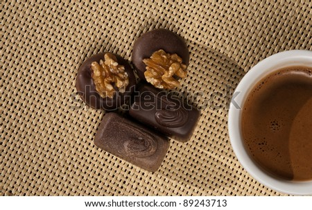 Cup of coffee and Chocolates on a decorative  napkin