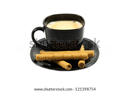 Cup of coffee and cinamon on white background