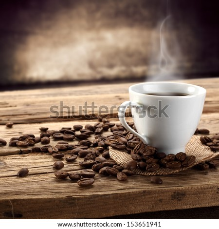 cup of coffee and coffee beans  #153651941