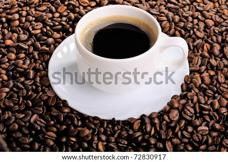 Cup of coffee and coffee beans background - stock photo