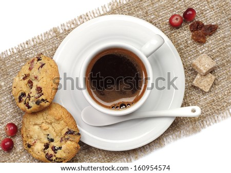 Cup of coffee and cookies on sacking closeup. Top view - stock photo