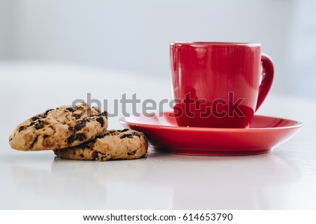 Cup of coffee and cookies on white background