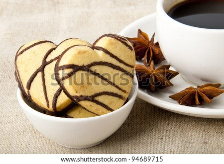 cup of coffee and cookies with chocolate