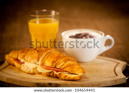 cup of coffee and croissant for breakfast