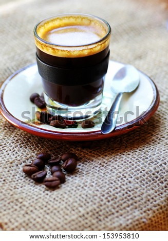 cup of coffee and grains on table
