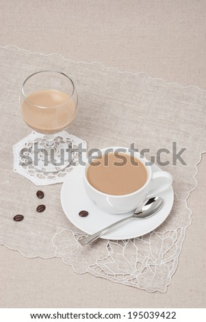 Cup Of Coffee and Irish Cream Liquor. Natural Linen Background. #195039422
