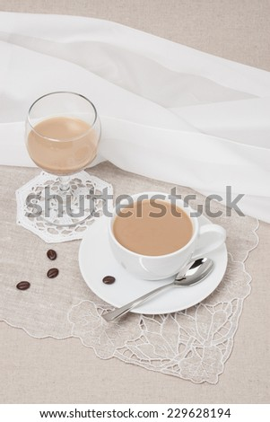 Cup Of Coffee and Irish Cream Liquor. Natural Linen Background. #229628194