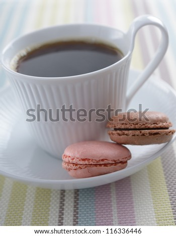 Cup of coffee and macarons