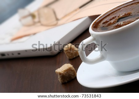 Cup of coffee and newspaper - stock photo