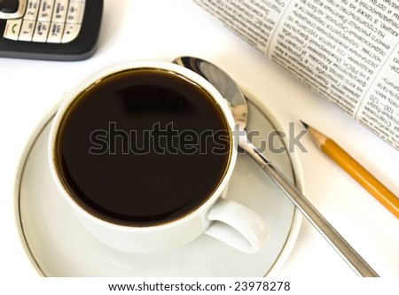 Cup of coffee and newspaper on white background