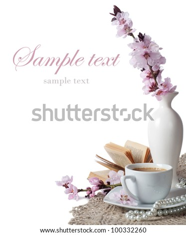 cup of coffee and pink cherry blossoms on a white background