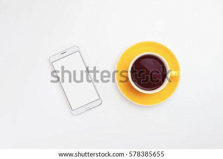 cup of coffee and smartphone on white background.  #578385655