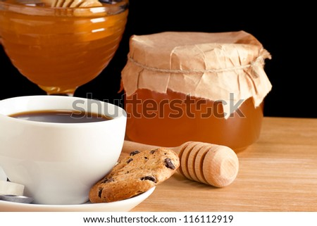 cup of coffee and sweets isolated on black