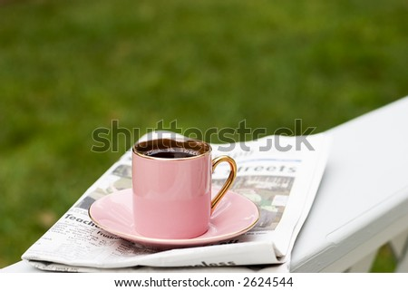 Cup of coffee and today's newspaper is a good start for a day - stock photo
