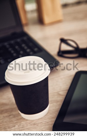 Cup Of Coffee And Work Equipment On Working Desk