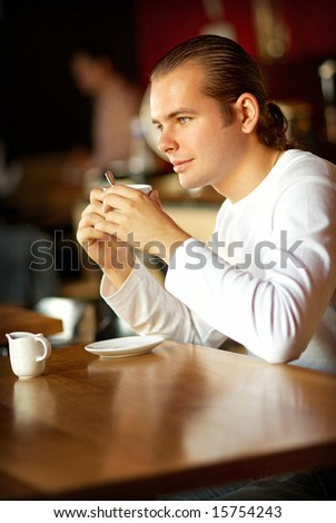 Cup of coffee and young man