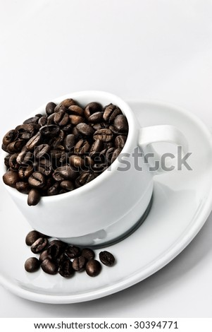 Cup of coffee beans. - stock photo