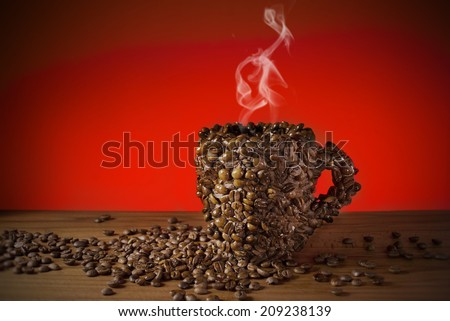 Cup of coffee beans, Made a coffee cup with coffee beans, Real photo, not 3D render. Smoke made with adobe photoshop cs6.  #209238139