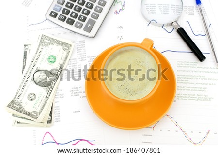 Cup of coffee, business objects and paper with graphs. Business concept