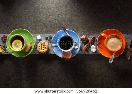 cup of coffee, cacao and tea on wooden background #566920462