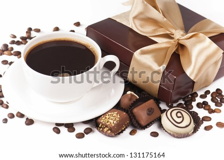 cup of coffee candies chocolate white dark dairy grains of coffee and box gift packing