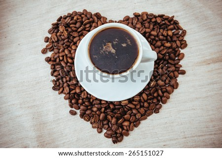 Cup of Coffee. Coffee beans in shape of heart. coffee beans isolated on white background. roasted coffee beans, can be used as a background.