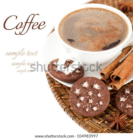 Cup of coffee, cookies, cinnamon and star anise