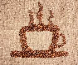 cup of coffee from beans on sackcloth background