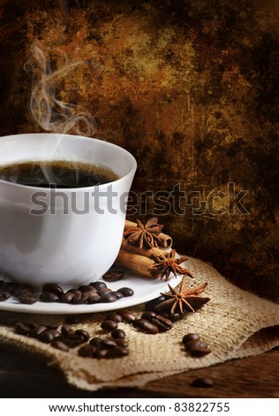 Cup of coffee  in front of rustic wall