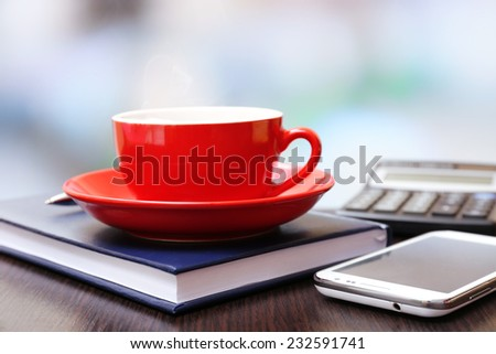 Cup of coffee in office