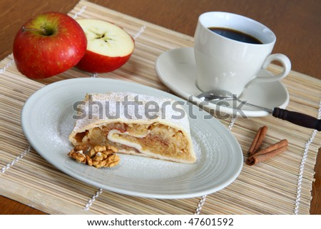 cup of coffee in white porcelain with apple strudel - stock photo