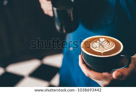 Cup of coffee latte art with coffee shop. #1038693442