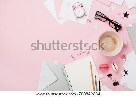 Cup of coffee, macaron, alarm clock, office supply and clean notebook on pink pastel table top view. Flat lay. Beautiful morning breakfast. Fashion woman blogger working desk. #708849634