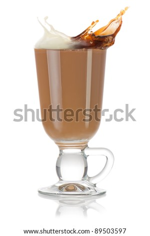 Cup of coffee. Milk and black coffee splashing and mixing into cappuccino on white background