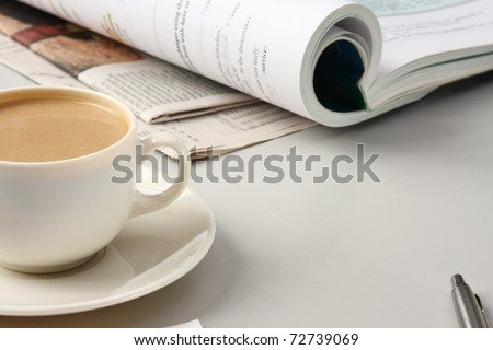 Cup of coffee near press