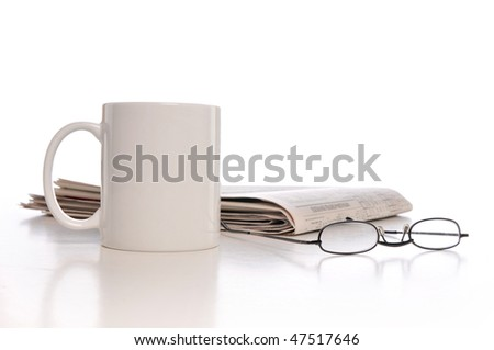 Cup of coffee, newspaper and glasses isolated on a white background