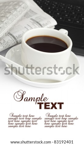 cup of coffee,newspaper and notebook with sample text