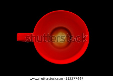 Cup of coffee on a black background.