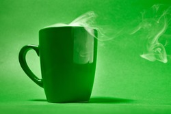 cup of coffee on a green background