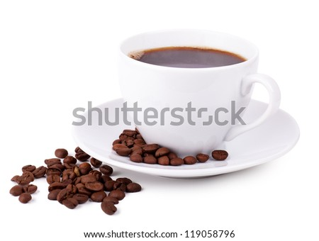 Cup of coffee on a plate with coffee beans