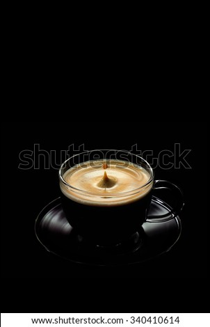 Cup of coffee on black background #340410614