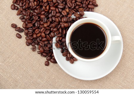 Cup of coffee on Food and Drink conceptual theme/Black coffee, a cup of beans
