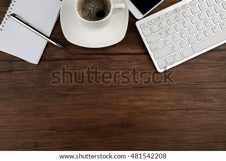 Cup of coffee on modern workplace #481542208