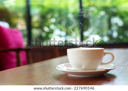 cup of coffee on table in cafe ,Morning light