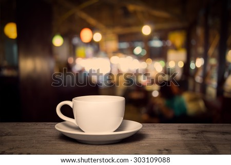 royalty-free cup of coffee on wooden table with… #312471974 stock
