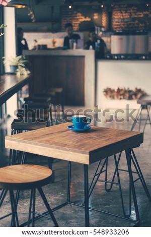 cup of coffee on table in cafe  ...