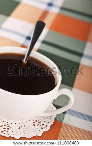 Cup of coffee on the kitchen table