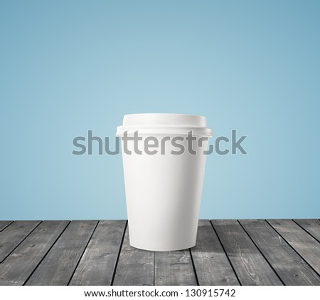 cup of coffee on wood table - stock photo