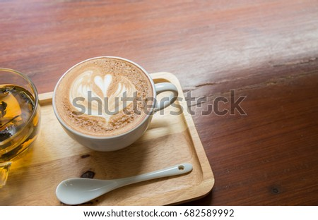 Cup of coffee on wooden table with cup of tea #682589992